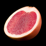 Orange grapefruit on black background Stock Photo