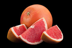 Orange grapefruit on black background Royalty Free Stock Images