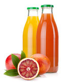 Orange and grapefruit juice bottles royalty free stock photography