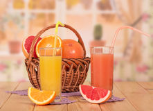 Orange and grapefruit juice in glasses Stock Photo