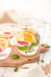 Orange Grapefruit and Mint Detox Water. On wooden table Stock Photos