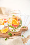 Orange Grapefruit and Mint Detox Water. On wooden table Royalty Free Stock Image