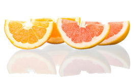Orange and grapefruit peaces with reflection Stock Photography