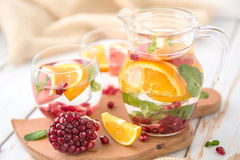 Orange Grapefruit Pomegranate and Mint Detox Water. On wooden table Stock Image