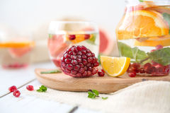 Orange Grapefruit Pomegranate and Mint Detox Water. On wooden table Royalty Free Stock Photo