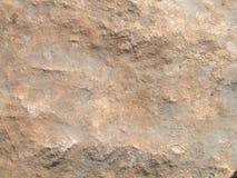 Orange-grauer rauer Steinhintergrund Stockfotos