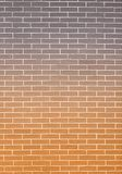 Orange gray brick wall as background or texture Royalty Free Stock Image