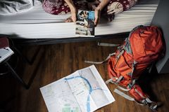 Orange and Gray Hiking Backpack on the Floor Stock Photo
