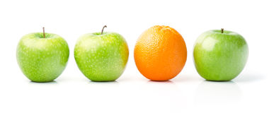 Orange Among Green Apples. Fresh Orange Among Green Apples, Isolated on White Royalty Free Stock Photos