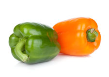 Orange and green bell peppers Stock Image