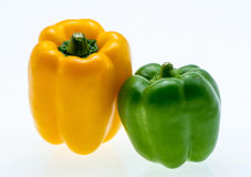 Orange and green bell peppers. on white background. Stock Photos