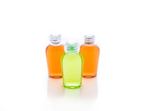 Orange and green bottle of shampoo, gel, soap Royalty Free Stock Photos