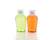 Orange and green bottle of shampoo, gel, soap Royalty Free Stock Images