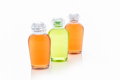 Orange and green bottle of shampoo, gel, soap Royalty Free Stock Photo