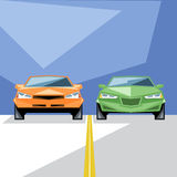 An orange and green cars at start for a racing Royalty Free Stock Photos