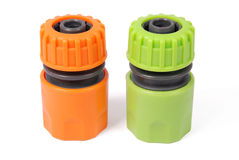 Orange and green garden water hose nozzle and connectors Royalty Free Stock Image