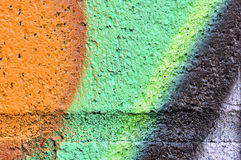 Orange an green grafiti wall detail Royalty Free Stock Images