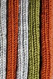 Orange, green and grey wool knitted texture. Orange, green and grey wool knitted texture background stock photos
