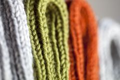 Orange, green and grey wool knitted texture stock photos