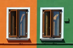 Orange and green house with two windows Royalty Free Stock Photography