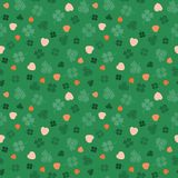 Orange and green Irish symbols design with hand drawn shamrocks and hearts. Seamless vector pattern. Ideal for St Patricks day, paper, scrap booking and as stock illustration