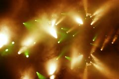 Orange-green light-show. Nice orange and green spot lights at concert Stock Photos