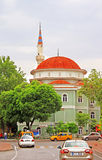 Orange and green mosque in Anyalya Stock Images