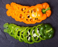Orange and green paprika peppers Stock Photo