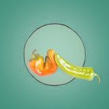 Orange and green pepper Stock Photo