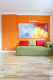 Orange and green room. Modern room with colorful wall and sofa Royalty Free Stock Photography