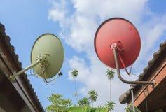 Orange green Satellite Dish under blue sky Stock Photos