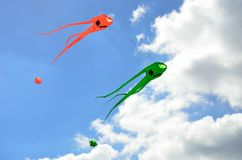 Orange and green space invader kites Stock Photos