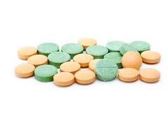 Orange and green tablets Stock Photo