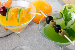 Orange and green vegetables cocktails on sand Royalty Free Stock Photography