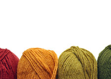 Orange and Green Yarn. Four skeins of yarn in a row against white Stock Photos
