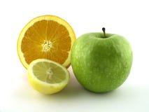 Orange, green, yellow. Green apple and orange nad lemon stock photo