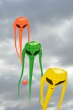 Orange green and yellow Space Invader Kites. In portrait Stock Photos