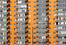 Orange and grey brick house with many windows and balcony Royalty Free Stock Photo