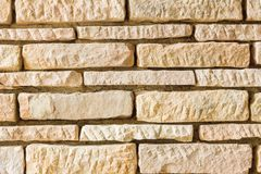 Orange grunge brick wall background, with deep gaps Stock Photo