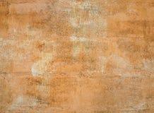 Orange grunge cement wall texture background Stock Photo
