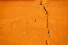 Orange grunge cracked wall background Stock Image
