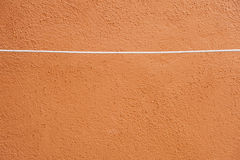 Grunge orange wall with rope Stock Photos