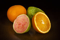 Orange and Guava. Fruits: Orange and Guava cut in half Stock Photography