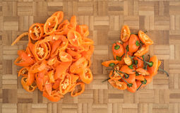 Orange habanero peppers on a wood cutting board Stock Photo