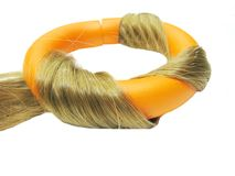 Orange hair roller in hair wave Royalty Free Stock Photography