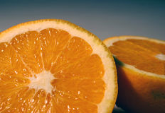 Orange half. An orange sliced into two halves royalty free stock photography