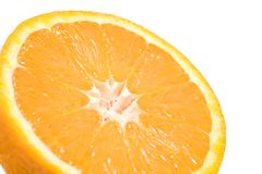 Orange half. Macro with shallow depth of field, focus on center and isolated over white Stock Photo