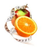 Orange half apple and measure tape Royalty Free Stock Photos