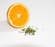 Orange Half with Garnish. Half an orange with parsley garnish on white background stock photos