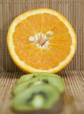 Orange Half and Kiwi Slices Royalty Free Stock Photos
